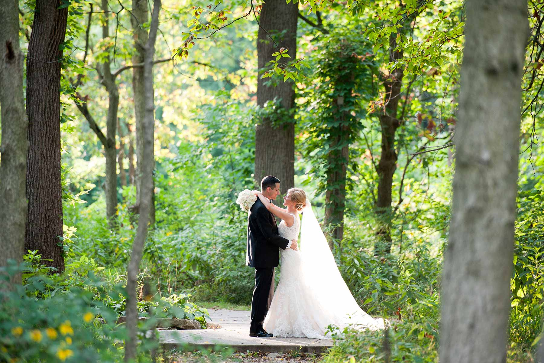 Creekside bride and groom in the woods